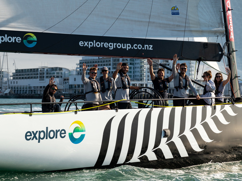 friendly Explore crew and passengers on an America's Cup Sailing yacht